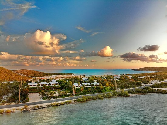 Sunset glow over Harbour Club Villas between ocean and lake