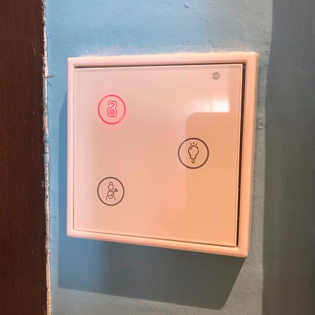 Buttons for do not disturb or calling the maid.
