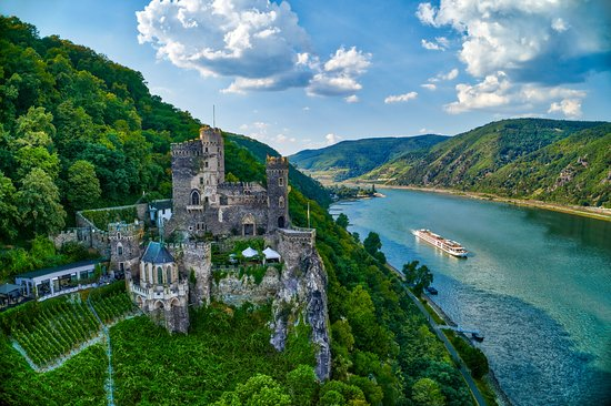 Trechtingshausen, Almanya: Glide down the river for a breathtaking view of the Rheinstein Castle. Ready to explore? Click the link in our intro!