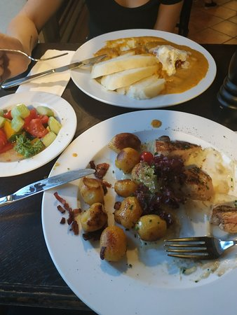 Tenderloin pork with sour cream and roast potatoes, veal with vegetable sauce and raspberries