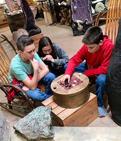 A serious game of checkers at Elijah Mountain Gem Mine. Wonder if the winner gets the large emerald in the foreground!