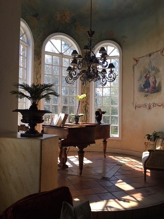Grand piano in a circular room off the common room.