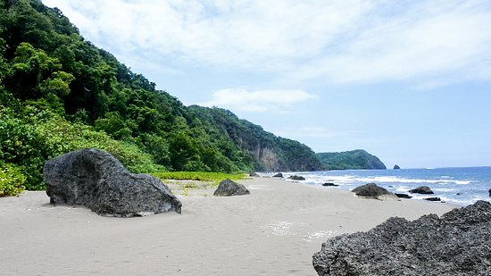 """Malekula Island, Vanuatu: Black sand beaches, ancient old stones and giant cliff faces found in North East Malekula """"End of the road"""" as the locals describe the location and still a hidden secret to most who have travelled Vanuatu."""