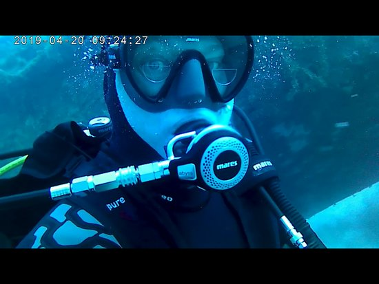 Aquatica Dive Centre: My with the wreck behind me