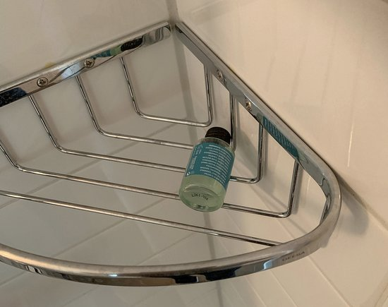 Impractically sized shampoo and shower gel bottles that fall straight through the soap shelf.