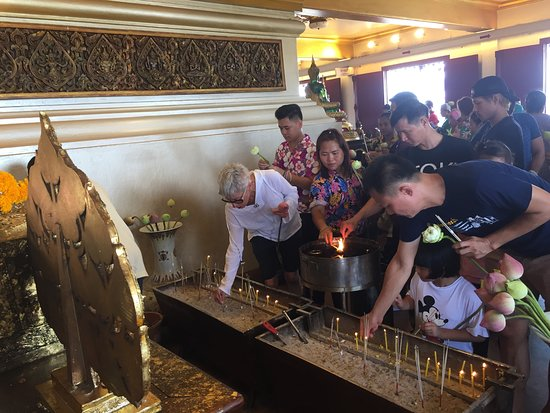 Lighting a candle for prayer