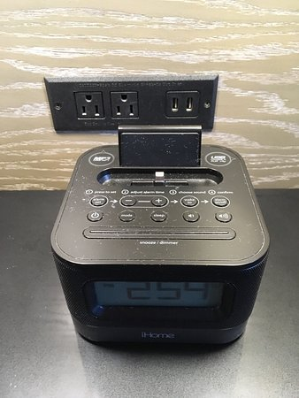 Clock and power outlet with USB.