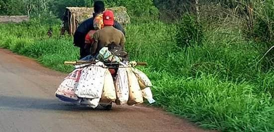 Bouar, Centraal- Afrikaanse Republiek: Motorcycle with heavy load
