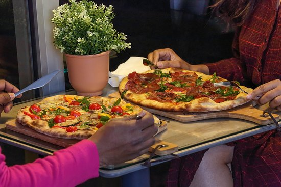 Che Figata Pizzaria, uma ambiente agradável e confortável para marcar o seu encontro e saborear um delicioso jantar em otima companhia!