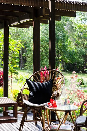From the deck, enjoy views across the lush tropical gardens.