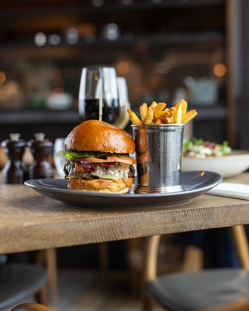 Dry-aged beef burger, streaky bacon, tomato relish & mature Cheddar