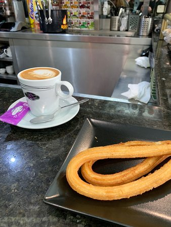 Love this little local place. Full of locals even having a small beer at 1pm. Staff don't speak English but that's not the point, as this is the Capital of Spain. Inexpensive and a genuine feeling of actually being a part of the local flea markets and the atmosphere of an era of Madrid that might sadly disappear. Opt for the salted Churros, much nicer and more unusual to find.