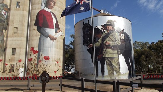 Devenish Silo Art: The area in front of the silos has been tranformed into the community's War Memorial.