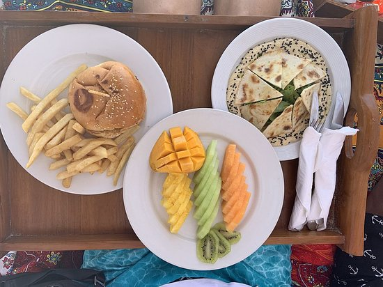 Hummus, Fruit plate, and burger with fries.
