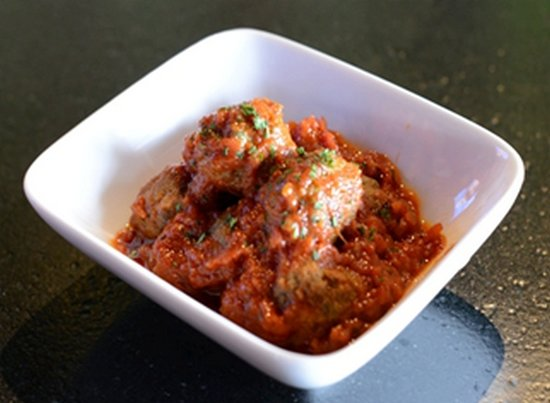 Piola's Meatballs Homemade meatballs slow cooked in San Marzano tomato sauce, served with focaccia sticks.