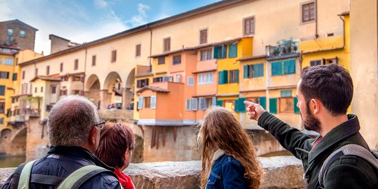 Showing the beauty of Ponte Vecchio to some clients in Florence.