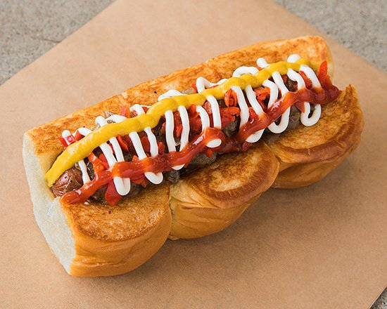 DOWNTOWN – smoked bacon wrapped dog, caramelized onions, pickled peppers, mayo, mustard, ketchup