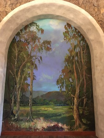 Large painting on wall of unused banquet area.