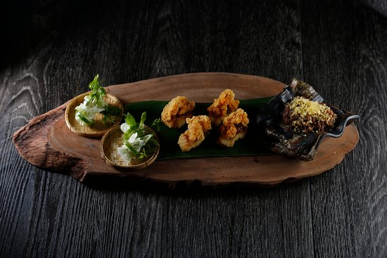 Deep-fried mackerel served with stir-fried chili dip and seasonal fruits