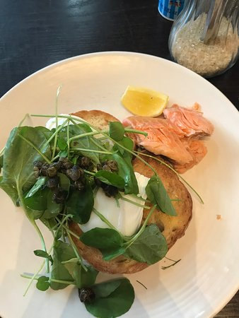 Hot smoked salmon with poached eggs,crispy capers and ciabatta toast...23$