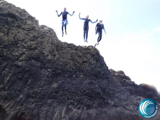 Coasteering Morning Trip in Ballintoy: Jumping from the rocks into the sea