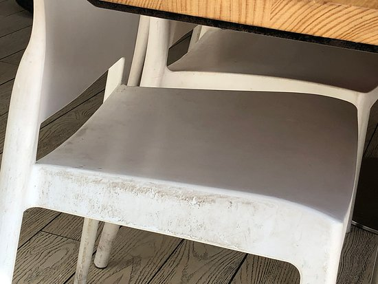 Watermark Restaurant & Bar: Ingrained dirt on all white plastic chairs, front & back