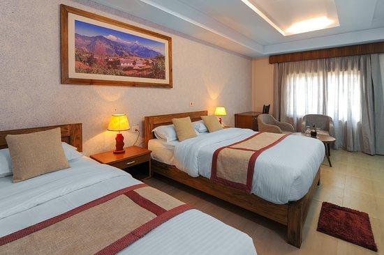 Capital O 653 Seven Lakes Resort: Family Room
