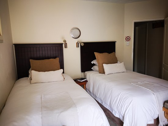 Twins -  Whether it be a business trip or getaway bringing you to Secunda, Dormio Manor Guest Lodge has the perfect room to suit your needs.  The twin room is ideal for guests requiring separate beds. An inter-leading door to Moulin Rouge, making it an ideal family unit. Twins Room is fitted with extra length tree-quarter beds where you can rest and recharge.