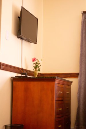 Lilongwe, Malaui: A satellite TV with chest of drawers with granite topping in all rooms.