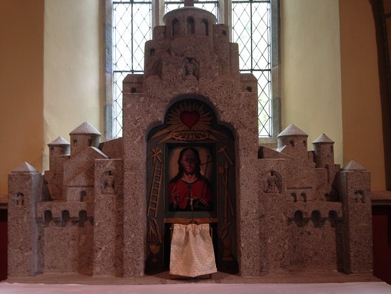 St Hilary Church: Altar carved in local stone enclosing a work by an artist