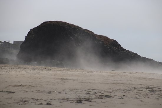 A huge rock on the beach