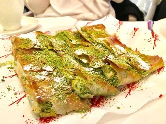 Pistachio and cream filling dessert in filo pastry.