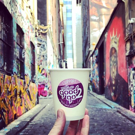 Enjoy a coffee while you observe the street art on Hosier Lane