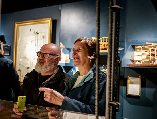 The MAD Museum. A couple watching The Kitchenator - an exhibit made by the museum's founder, Richard Simmons.