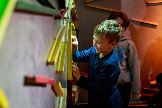 The MAD Museum. A boy building marble runs in the MAD Zone.