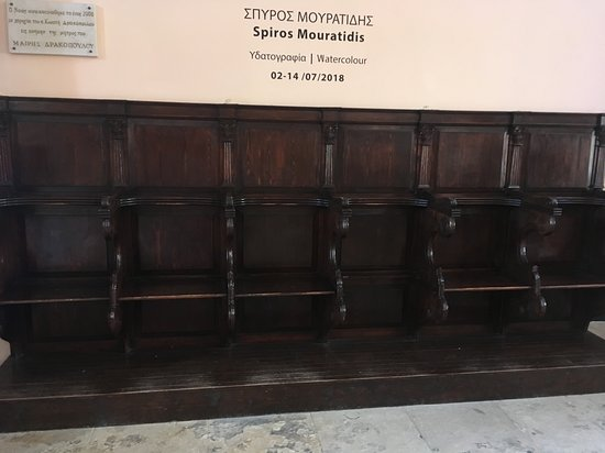 Priest's seats and water colour sign.