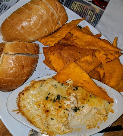 blu crab dip: rich creamy blu crabhouse crab dip & melted monterey jack cheese served with ancho-honey cheddar cheese tortilla chips and a baguette for dipping.