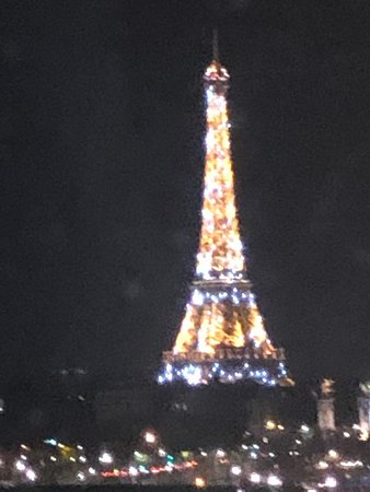 This is 3rd floor view from the room at night when they light up Eiffel with 20,000 lights.