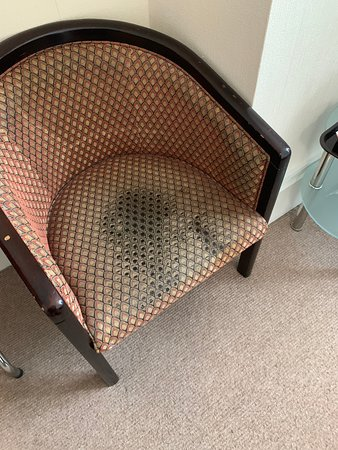 Room 574 - Chair stale crisps in it