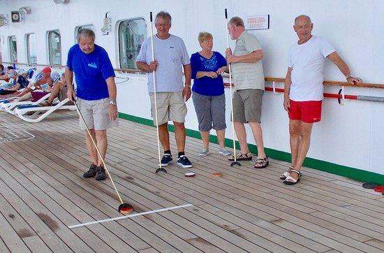Columbus: An international group of shuffleboarders:  Dutch, German, Australian, New Zealanders, Americans, Belgian, English, Scots and Welsh.