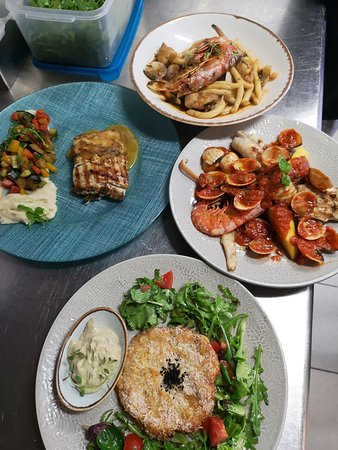 Seafood at it's best - fish fillet, sea delicacies, crabcake, fish stew