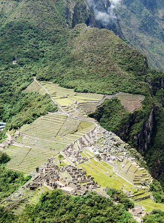 View of Machu Picchu from the mountain Huayna Picchu. The trekking to Huayna Picchu became famous, to reserve it 4 to 6 months in advance, there are 400 people per day, from the top you can see the imposing citadel of Machu Picchu and its surroundings.