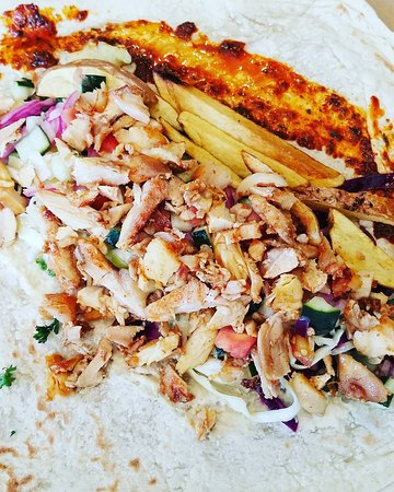 Chicken Shawarma with fries, salads, and extra spicy sauce!