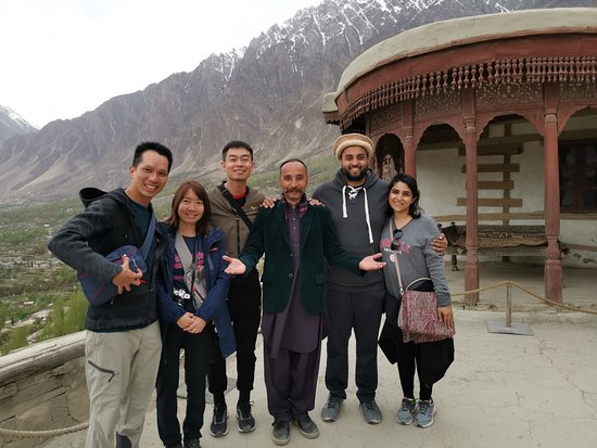 Our Singaporean Guest at Baltit Fort (800 years old castle) in Hunza Valley. Book a Trip to Explore North Pakistan with us.