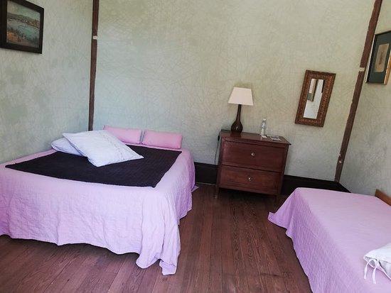la chambre verte de la suite avec terrasse