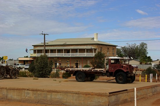 Hotel with Tom Kruse's old mail truck in the foreground on the old Ghan line platform