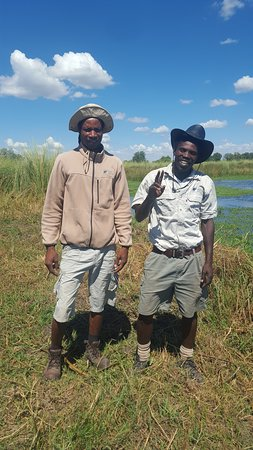 """Jumbo Junction Camp: Jumbo Junction ace guides Monoso and Technic posing in front of """"Hippo Pools,"""" a boat ride away from Jumbo Junction camp on Easter Sunday morning, 21 April 2019."""