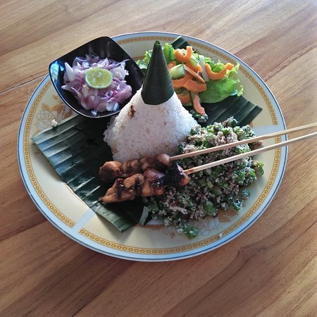 Nasi jukut urab:mick vegetable with coconut souce and sate ayam with viramid of rice.