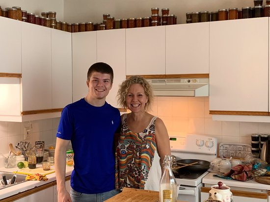 A l'Adresse du Centre-Ville: Natalie and her son preparing breakfast-- see her preservatives at the top of cabinets!!  Truly, someone who loves what she does!!