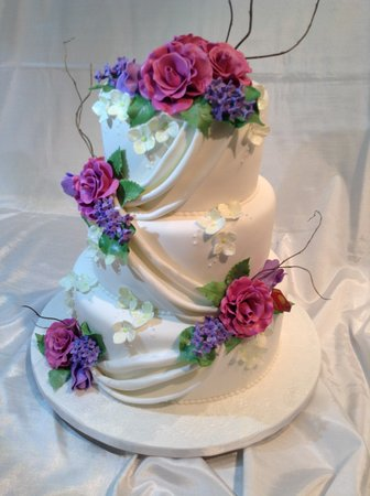 Dundas, Canada: Elegant wedding cake featuring all edible flowers and curly willow.